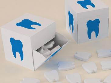 Custom moulded mints in dent tooth shaped logo
